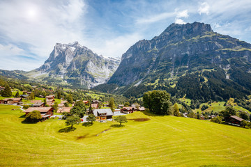 Fototapete - Impressive view of alpine Eiger village. Popular tourist attraction. Location place Swiss alps, Grindelwald valley, Europe.