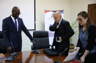 Oxfam's Ticehurst and Massot speak with Haiti's Minister of Planning and External Cooperation Aviol Fleurant before a meeting in Port-au-Prince