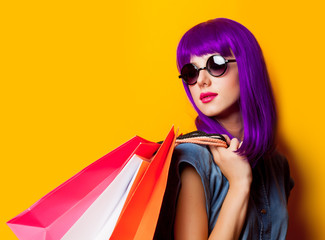 Young girl with purple hair and shopping bags