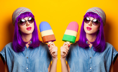 Young girl with purple hair and ice-cream toy