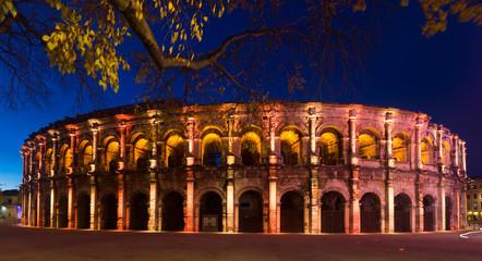 Panorama of illuminated Roman amphitheater, Nimes