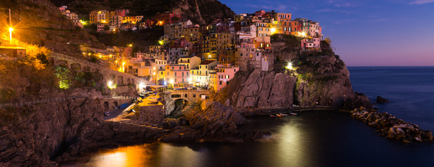 Colorful houses of Manarola, La Spezia in evening from sea view