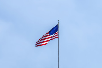 United States of America Flag over a clear blue sky backgound