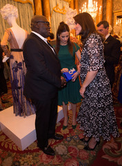 Catherine, Duchess of Cambridge talks to Vogue Editor Edward Enninful at a reception to celebrate the Commonwealth Fashion Exchange at Buckingham Palace in London