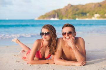 Couple on a tropical beach at Mahe island, Seychelles