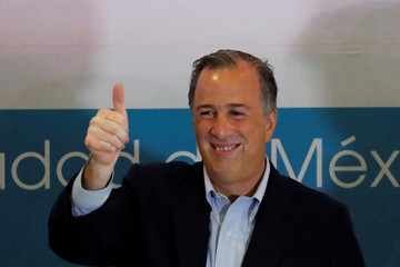 PRI presidential candidate Jose Antonio Meade gestures to members of Nueva Alianza (New Alliance) party during an event in Mexico City