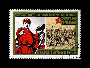 vintage poster and marching military volunteers, 50th anniversary of the Armed Forces of the USSR, circa 1968. canceled vintage postal stamp printed in the Soviet Union isolated on black background.