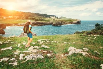 Girl traveler looks on beautiful sea landscape