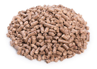 Heap of woody clumps, pellets of litter, for cat, rabbit, guinea pig, hamster, rodent, bird, turtle and other pets, isolated on a white background