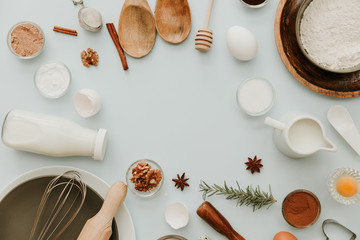 Baking utensils and recipe ingredients on pastel light blue background. Flat lay overhead text space images. Recipe book text space images.