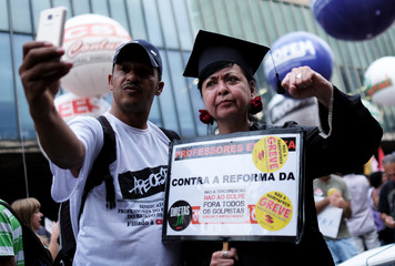 Demonstrators attend a protest against Brazil's President Michel Temer's proposal to reform the social security system in Sao Paulo