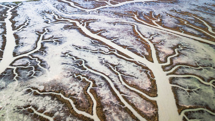 Drone view of a spectacular delta where a river flows into the sea