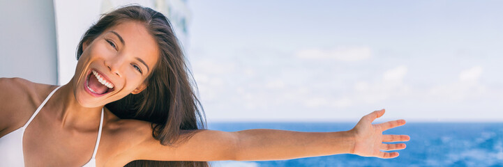 Cruise summer vacation fun on cruise travel holiday in caribbean. Asian girl with open arm in freedom happy excited. Panorama banner landscape crop tourist screaming of joy.