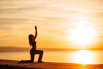 Carefree woman meditating in nature.Finding inner peace.Yoga practice.Spiritual healing lifestyle.Enjoying peace,anti-stress therapy,mindfulness meditation.Positive energy.Crescent lunge pose