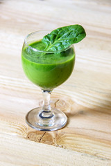 Fresh, homemade, healthy green detox juice from spinach, kiwi, avocado and parsley.