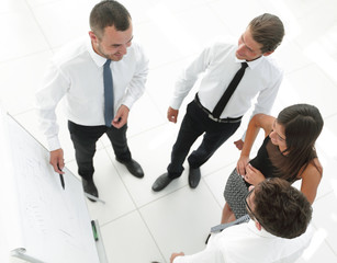 background image of a business team discussing new ideas.
