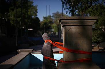 A statue covered with a blanket is pictured five months after the September 19 earthquake, in the La Condesa neighborhood in Mexico City