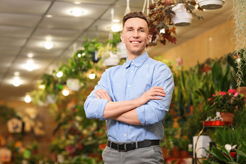 Portrait of young man in greenhouse. Small business owner