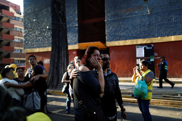 People react after an earthquake shook buildings of the Tlalpan housing project, five months after the September 19 earthquake, in the Educacion neighborhood in Mexico City