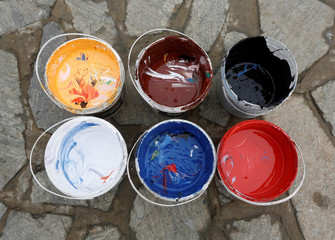 Containers of colours, prepared by Artlords which are used to paint graffiti on the concrete blast walls, are seen in Kabul