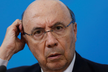 Brazil's Finance Minister Henrique Meirelles reacts during a news conference in Brasilia