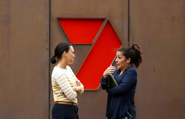 Women talk in front of the Channel 7 logo in Sydney