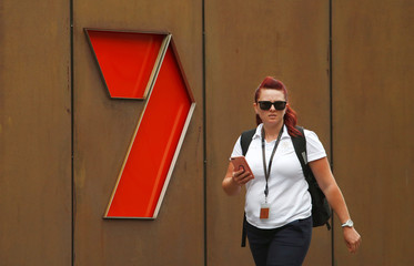 A woman walks in front of the Channel 7 logo in Sydney