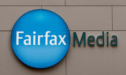 The company's logo is seen on the Fairfax Media building in Sydney
