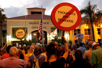 Protesters take part in a Call To Action Against Gun Violence rally by the Interfaith Justice League and others in Delray Beach