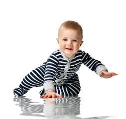 Infant child boy toddler in blue body with stripes sitting happy smiling