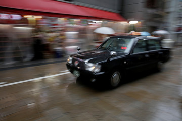 A taxi drives through a shopping district in Osaka