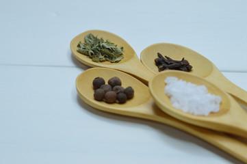 four spoons arrangement with spices close up