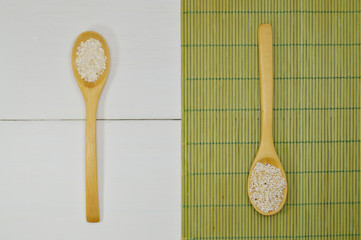 wooden spoons with oats and amaranth