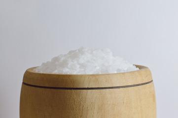 sea salt in wooden bowl close up
