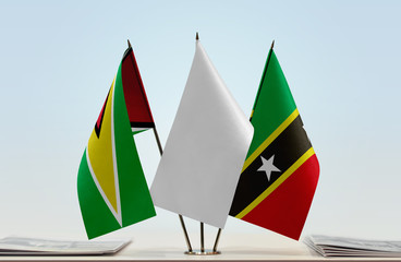 Flags of Guyana and Saint Kitts and Nevis with a white flag in the middle