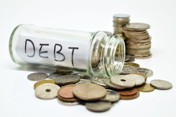 Debt lable in a glass jar with coins spilling out