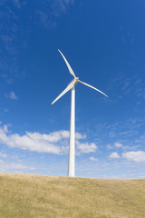 Wind turbine against clear blue sky