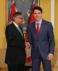 Canadian Prime Minister Justin Trudeau shakes hand with Tata Sons Chairman Natarajan Chandrasekaran during a meeting in Mumbai