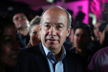 Former Mexican president Calderon attends an event where his wife Zavala, presidential independent pre-candidate, thanks her campaign staff for helping her to collect citizen's signatures, in Mexico City