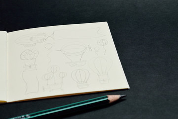notebook with pencil sketches of balloons