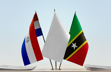 Flags of Paraguay and Saint Kitts and Nevis with a white flag in the middle