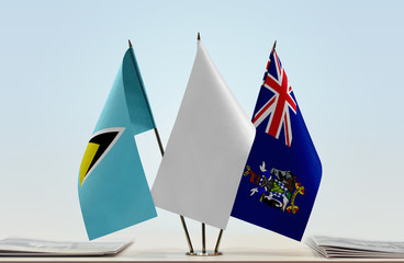 Flags of Saint Lucia and South Georgia and Sandwich with a white flag in the middle