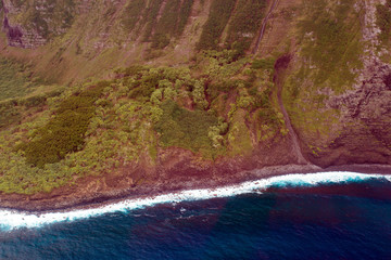 Coastline and surf on the island of Molokai in Hawaii, aerial shot from a small, low-flying prop plane