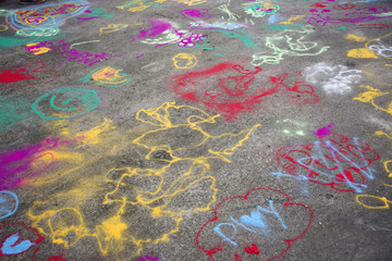 Thai children play and painting powder color on ground in Bang Mod festival