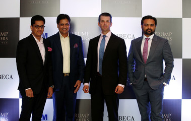 Donald Trump Jr., Basant Bansal, Chairman and Managing Director of M3M India, Pankaj Bansal, director of M3M India and Kalpesh Mehta, founder of Tribeca Developers, pose for photographers during a photo oppurtunity before a meeting in New Delhi