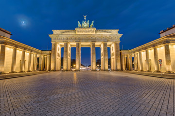 The famous Brandenburg Gate in Berlin illuminated at dawn