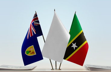 Flags of Turks and Caicos Islands and  Saint Kitts and Nevis with a white flag in the middle