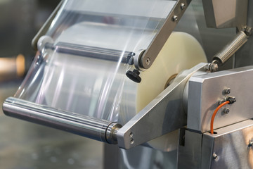 Automatic packing machine with plastic bag and paper box