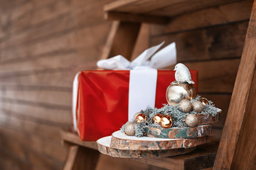 Beautiful Christmas decoration made by professional florist and gift box on wooden ladder