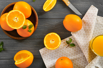 Juicy ripe oranges on table, top view